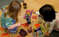 Our Research | Children painting together